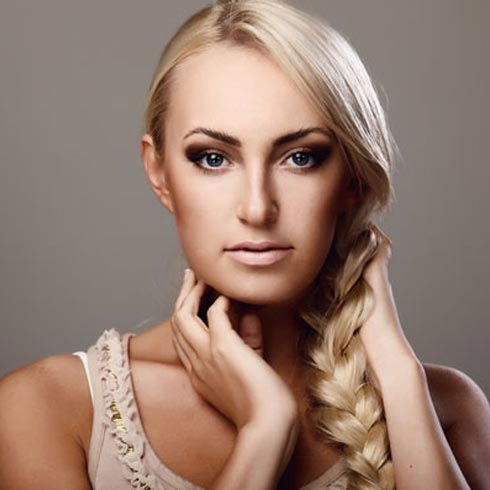 This simple and sleek side braid shows off healthy and thick long hair ...