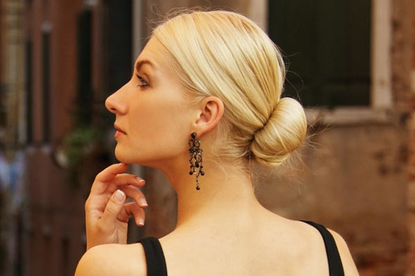 low bun is a chic and sophisticated cocktail party hairstyle that ...