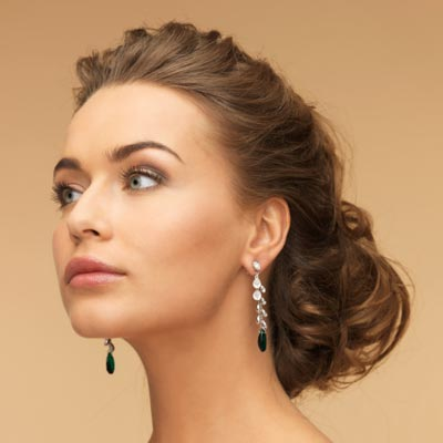 Before pull your hair back in a mid-height ponytail , work in a few