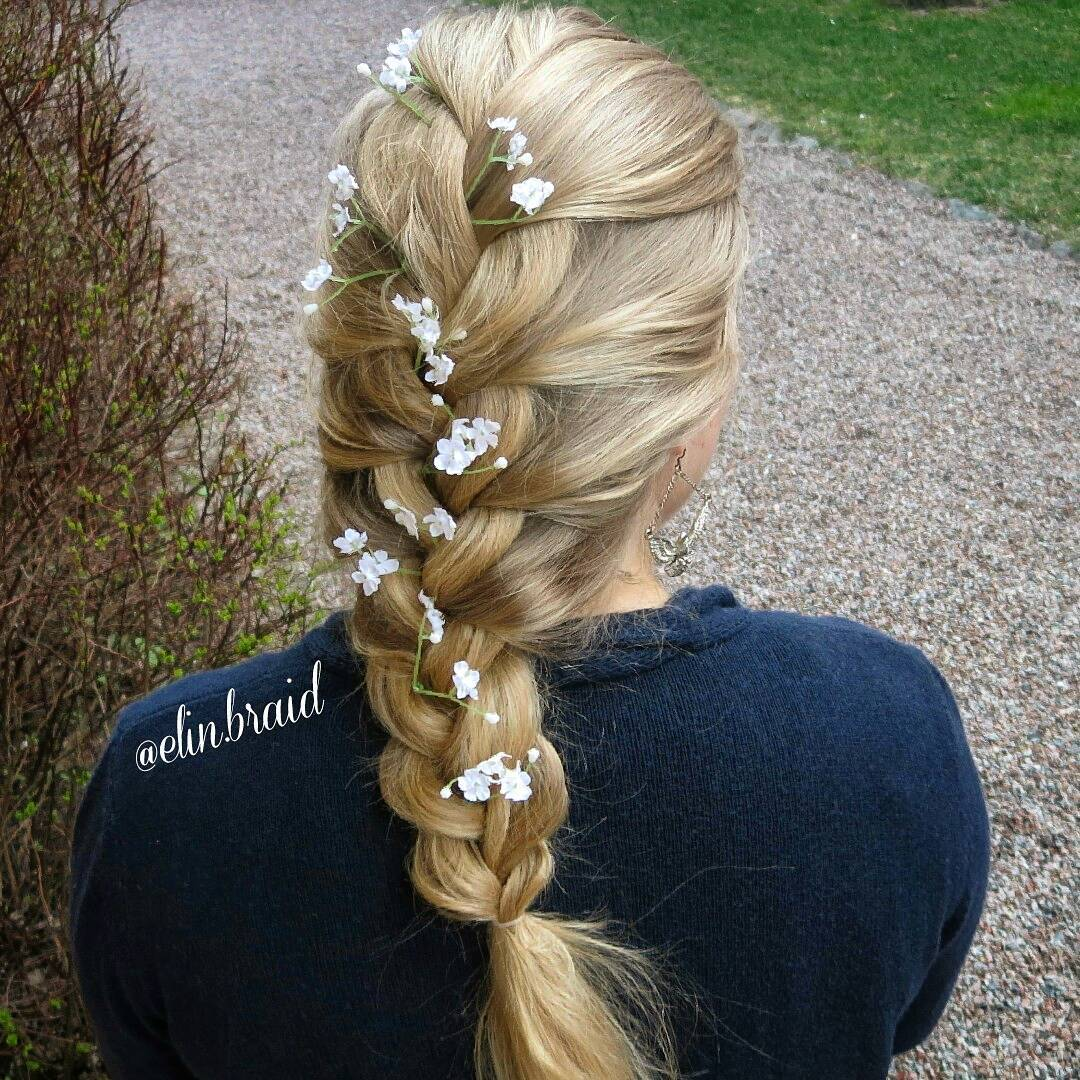 elinbraidfrenchbraidwithflowerslonghair hairstyle
